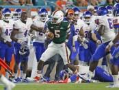 Miami (Florida) Hurricanes quarterback N'Kosi Perry runs the ball against the Savannah State Tigers