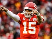 Kansas City Chiefs quarterback Patrick Mahomes II points to the sidelines in celebration after throwing a touchdown against the Indianapolis Colts during the first quarter of the AFC Divisional Round Playoff game