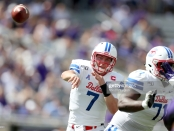 SMU Mustangs quarterback Shane Buechele attempts a pass against the TCU Horned Frogs