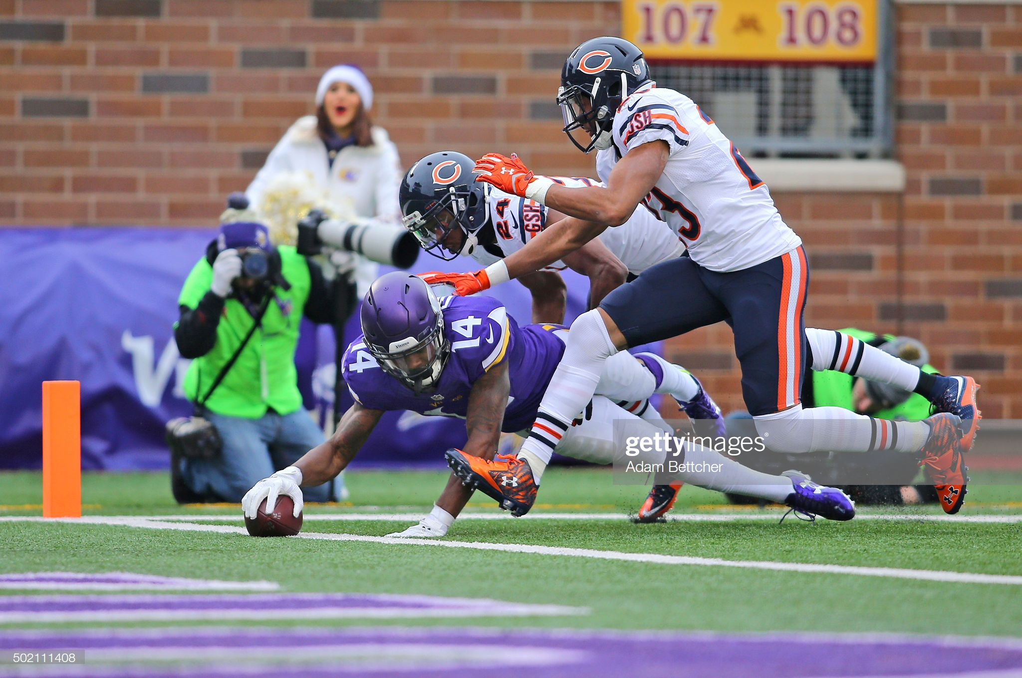 Minnesota Vikings wide receiver Stefon Diggs scores a touchdown as Kyle Fuller and Alan Ball defend him against the Chicago Bears