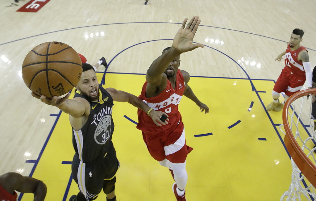 Golden State Warriors guard Stephen Curry attempts a layup against the Toronto Raptors in Game Six of the 2019 NBA Finals
