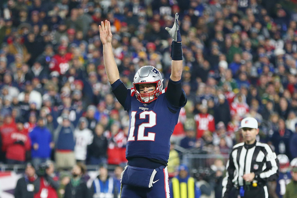 New England Patriots quarterback Tom Brady signals for a touchdown against the Green Bay Packers