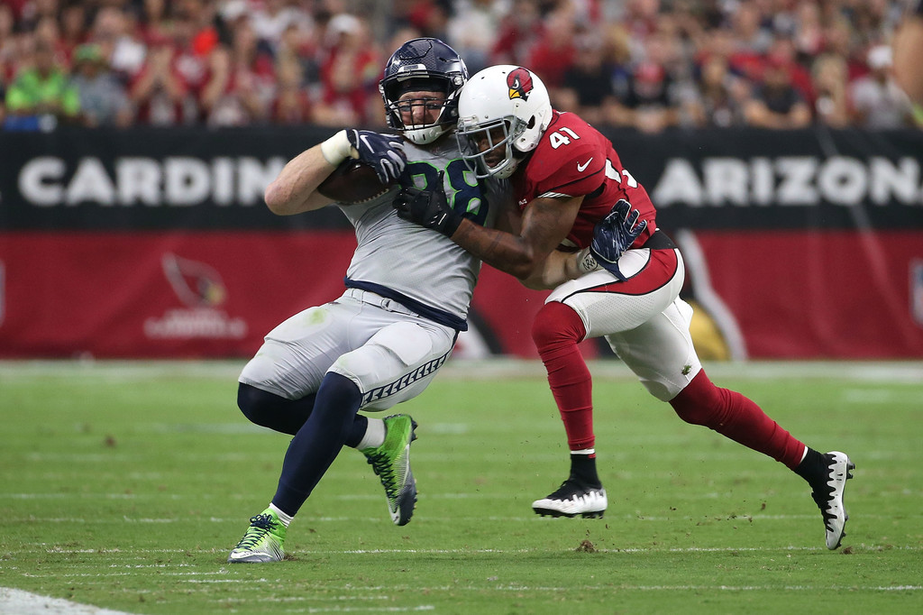 Seattle Seahawks tight end Will Dissly is being tackled by Antoine Bethea against the Arizona Cardinals
