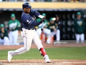 Tampa Bay Rays slugger Yandy Diaz hitting a home run off of Sean Manaea against the Oakland Athletics