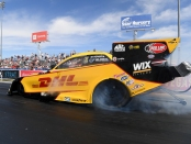 DHL Funny Car pilot J.R. Todd racing on Sunday at the DENSO Auto Parts NHRA Four-Wide Nationals