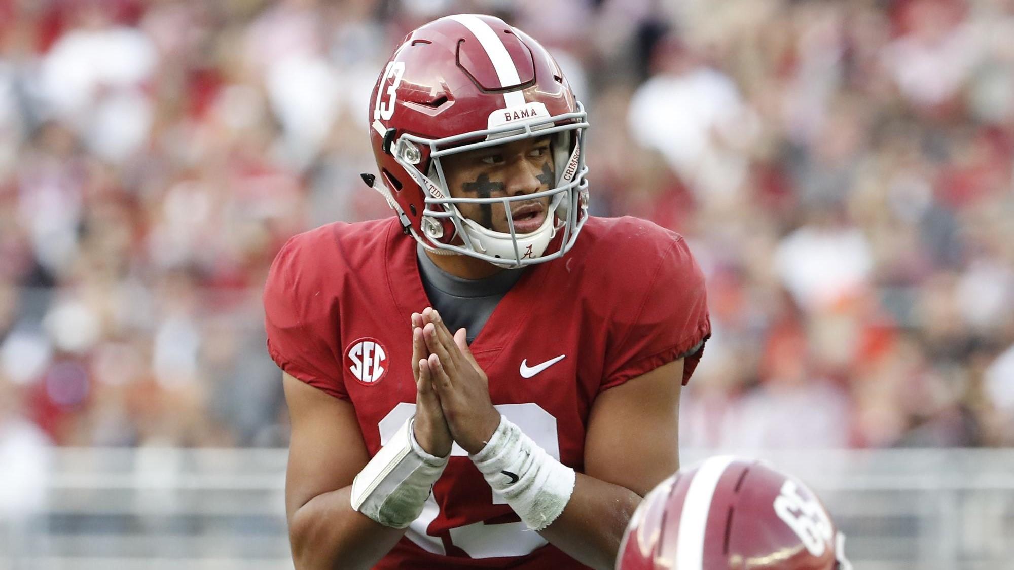 Alabama Crimson Tide quarterback Tua Tagovailoa getting ready to accept the snap against the Auburn Tigers