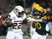 Northern Illinois Huskies running back Tre Harbison carries the ball against the Toledo Rockets