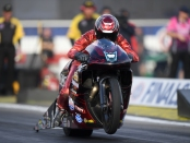 Denso/Matt Smith Racing Pro Stock Motorcycle rider Matt Smith racing on Friday at the Auto Club NHRA Finals