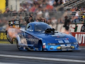 Mopar/Pennzoil sponsored Funny Car pilot Matt Hagan racing on Friday at the Auto Club NHRA Finals