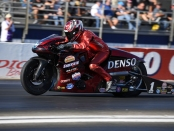 Denso/Matt Smith Racing Pro Stock Motorcycle rider Matt Smith racing on Saturday at the Auto Club NHRA Finals