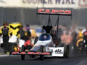 Capco Contractors Top Fuel Dragster pilot Steve Torrence racing on Saturday at the Auto Club NHRA Finals