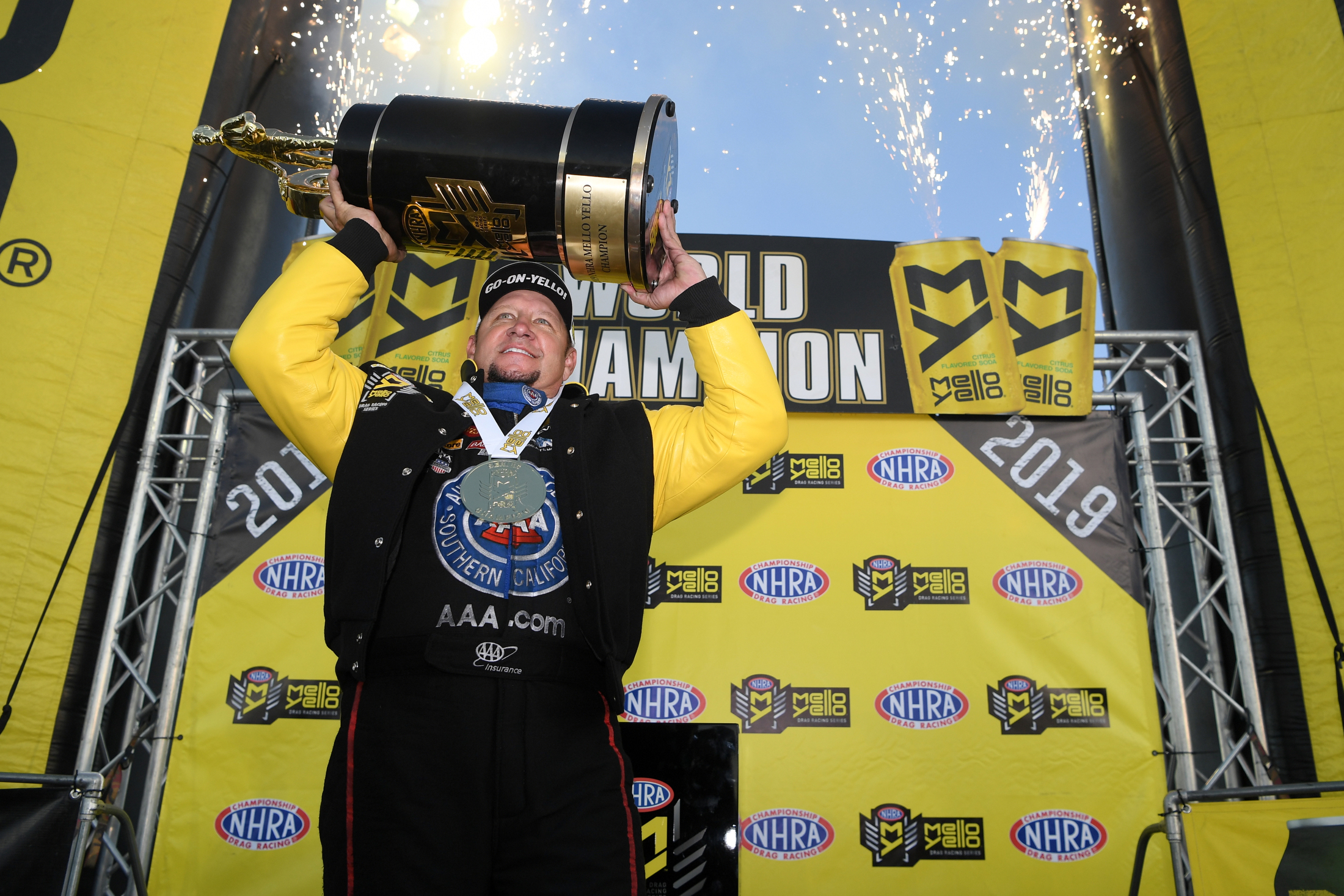 AAA of Southern California Funny Car pilot Robert Hight celebrating his 2019 Funny Car Championship at the Auto Club NHRA Finals