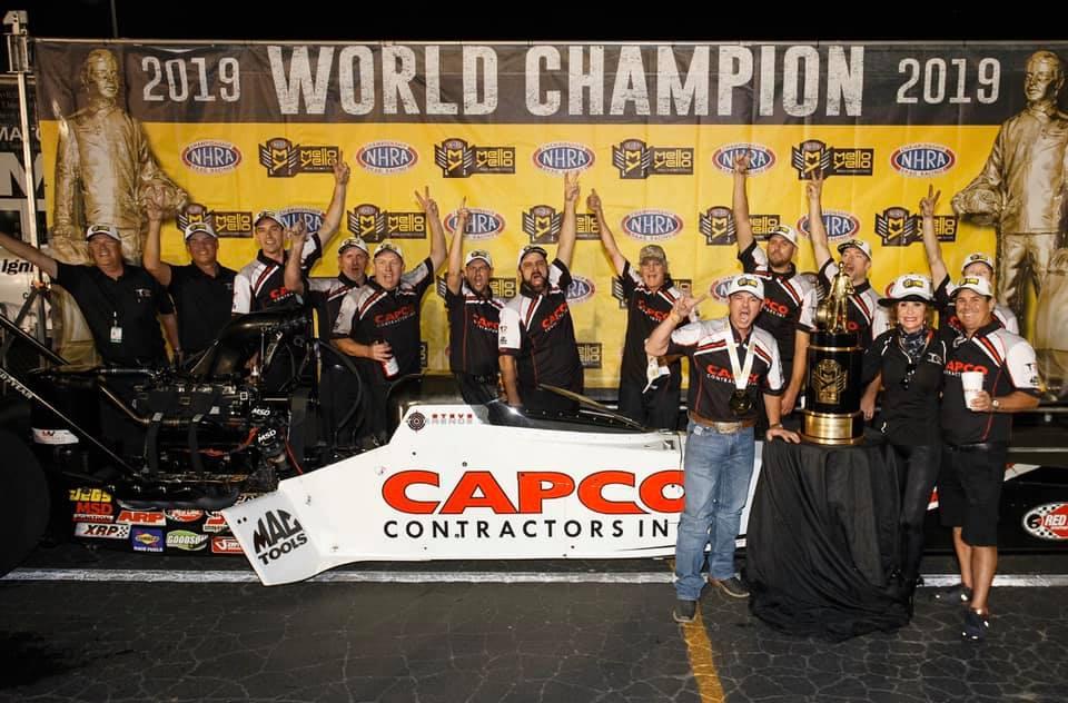 Capco Contractors Top Fuel Dragster pilot Steve Torrence celebrating his 2019 Top Fuel World Championship at the Auto Club NHRA Finals
