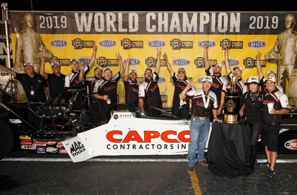 Capco Contractors Top Fuel Dragster pilot Steve Torrence celebrating his 2019 Top Fuel World Championship at the Auto Club NHRA Finals