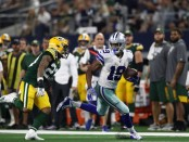Dallas Cowboys wide receiver Amari Cooper scores a touchdown after making a reception against the Green Bay Packers