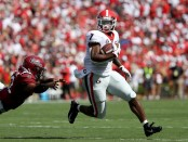 Georgia Bulldogs running back D'Andre Swift escapes a tackle by Steven Montac against the South Carolina Gamecocks