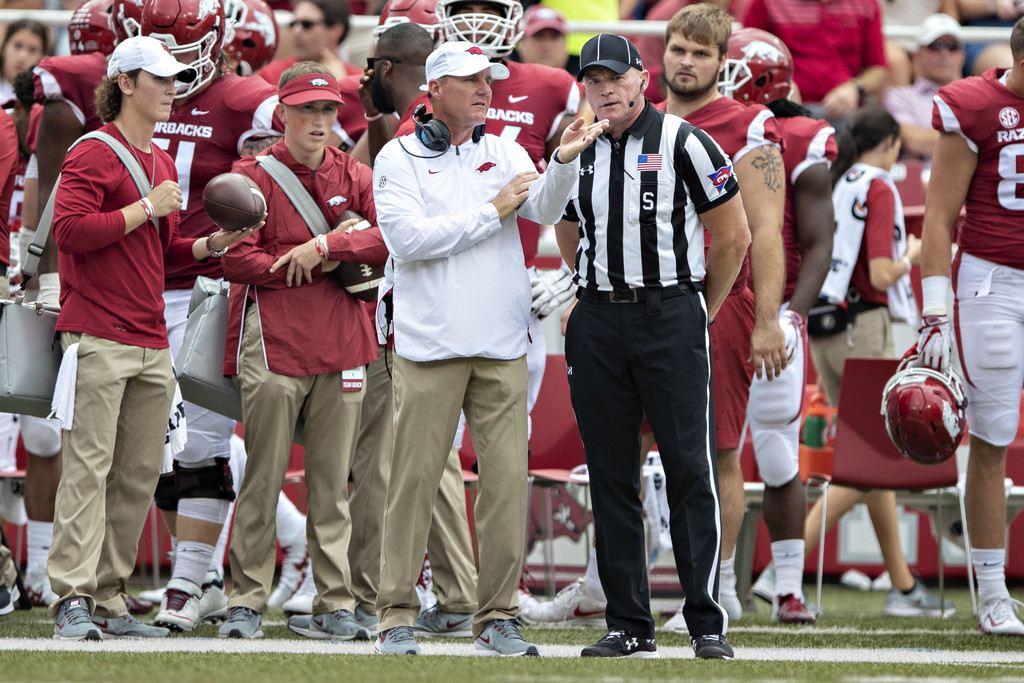 Former Arkansas Razorbacks head coach Chad Morris talks with an official on the sidelines against the Alabama Crimson Tide