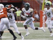 Baylor Bears running back JaMychal Hasty carries the ball against the Texas Longhorns