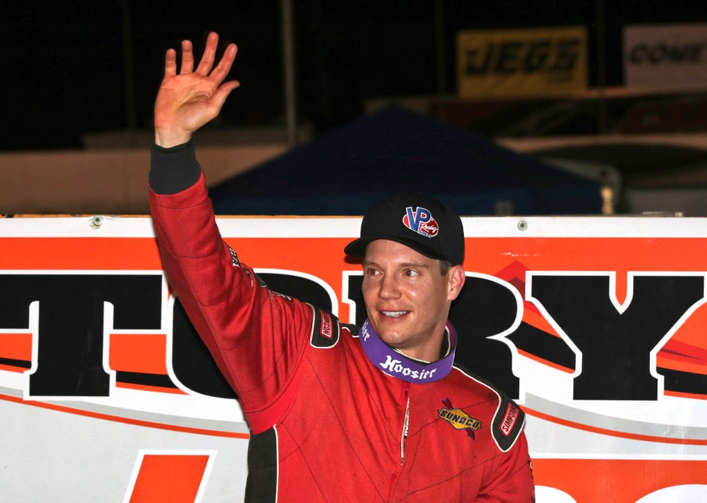 Driver Matt Hirschman waves to the crowd before a race in an undated photo