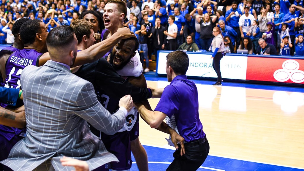 Stephen F. Austin Lumberjacks men's basketball team celebrates their first win over an AP No. 1 team with their upset over the Duke Blue Devils