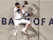 Los Angeles Dodgers outfielder Cody Bellinger makes a catch on the wall in Game Five of the 2019 National League Division Series against the Washington Nationals
