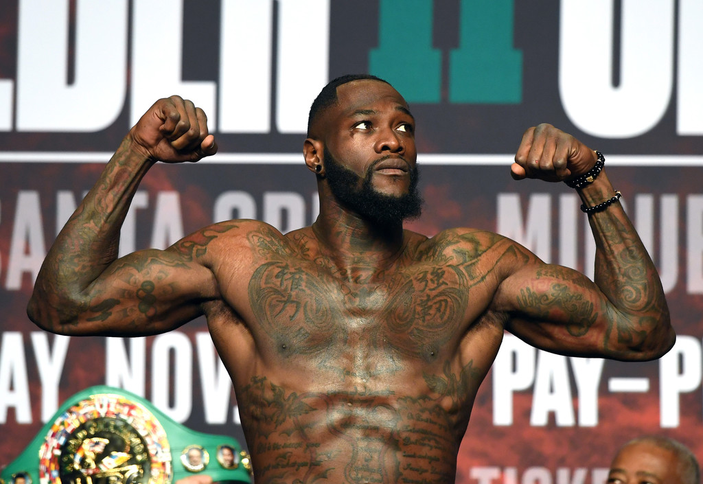 WBC heavyweight champion Deontay Wilder poses on the scale during his official weigh-in at MGM Grand Garden Arena before his fight with Luis Ortiz