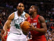 Miami Heat guard Dion Waiters drives to the basket against Al Horford against the Boston Celtics