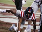 Ole Miss Rebels wide receiver Elijah Moore reacts following a touchdown against the Mississippi State Bulldogs during their Thanksgiving Day game