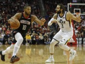 Houston Rockets swingman Eric Gordon drives to the basket while being guarded by Ricky Rubio against the Utah Jazz
