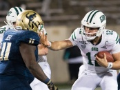 Ohio Bobcats quarterback Nathan Rourke carrying the ball against the Akron Zips
