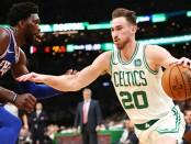 Boston Celtics small forward Gordon Hayward dribbles the ball against Joel Embiid against the Philadelphia 76ers