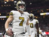 New Orleans Saints quarterback Taysom Hill celebrates a touchdown against the Atlanta Falcons during their Thanksgiving Day game