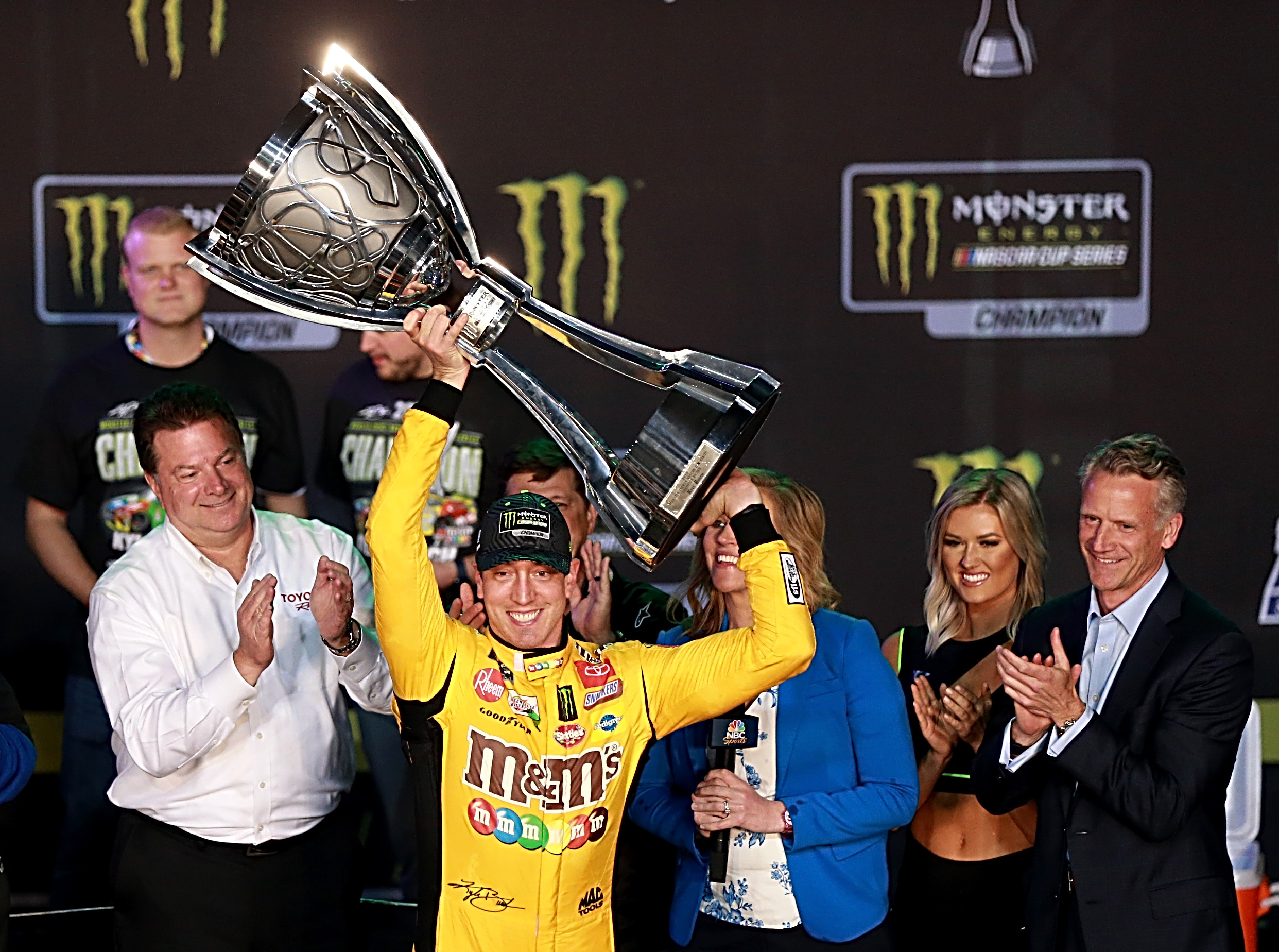 M&M's Joe Gibbs Racing driver Kyle Busch celebrates in Victory Lane after winning the Monster Energy NASCAR Cup Series Championship and the Monster Energy NASCAR Cup Series Ford EcoBoost 400 at Homestead Speedway