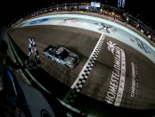 Chiba Toyopet Toyota driver Austin Hill takes the checkered flag to win the NASCAR Gander Outdoors Truck Series Ford EcoBoost 250