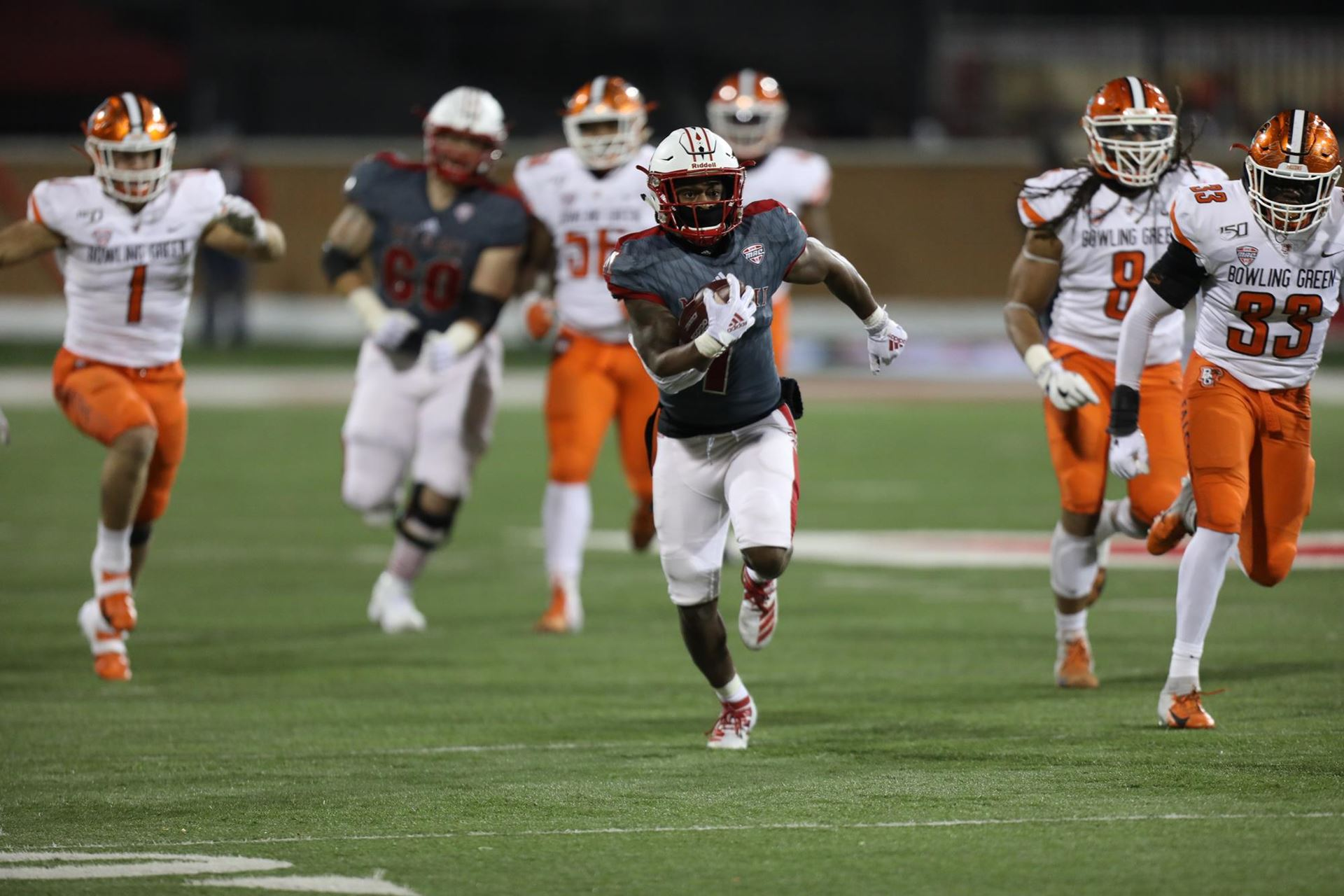Miami (Ohio) RedHawks running back Jaylon Bester carries the ball against the Bowling Green Falcons