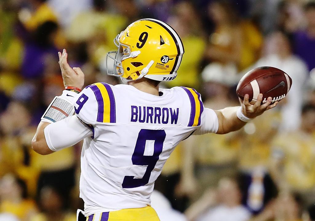 LSU Tigers quarterback Joe Burrow attempts a pass against the Mississippi Rebels
