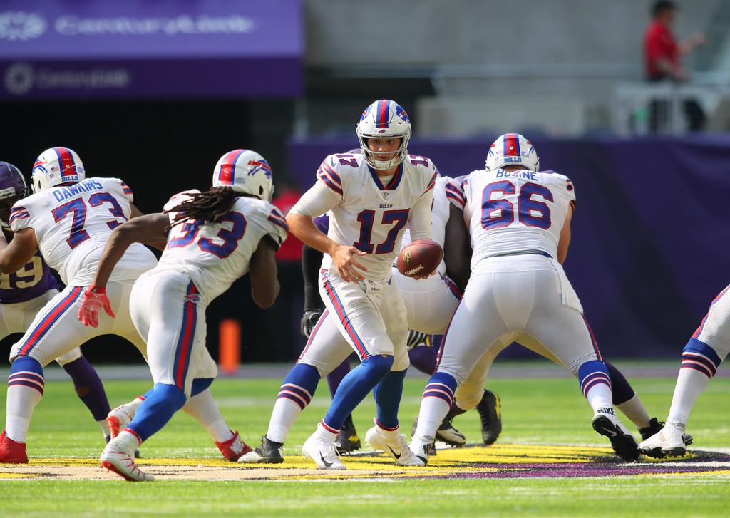 Buffalo Bills quarterback Josh Allen hands off the ball to Chris Ivory against the Minnesota Vikings