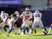Buffalo Bills quarterback Josh Allen hands off the ball to Chris Ivory against the Minnesota Vikings