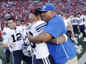 BYU Cougars head coach Kalani Sitake celebrates with Slone Takitaki after their win over the Wisconsin Badgers