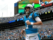 Carolina Panthers quarterback Kyle Allen reacts after his team scored a touchdown against the Jacksonville Jaguars