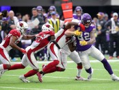 Minnesota Vikings tight end Kyle Rudolph caught a pass, then is tackles by several members of the Arizona Cardinals defense