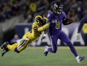 Baltimore Ravens quarterback Lamar Jackson is tackled by Los Angeles Rams defensive end Dante Fowler during the second half of an NFL football game