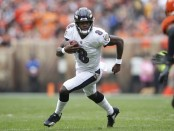 Baltimore Ravens quarterback Lamar Jackson runs with the ball against the Cleveland Browns