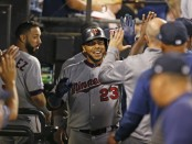 Minnesota Twins designated hitter Nelson Cruz celebrates a solo home run during the seventh inning against the Chicago White Sox