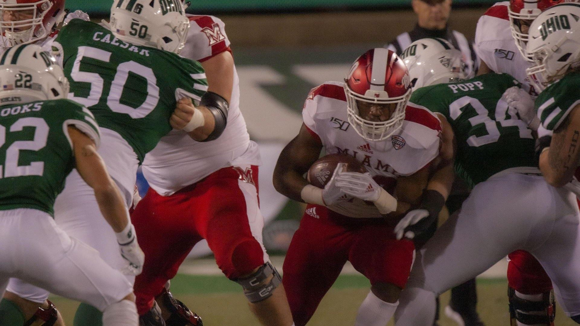 Miami (Ohio) RedHawks running back Jaylon Bester carries the ball against the Ohio Bobcats