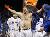 New York Mets slugger Pete Alonso celebrates with his teammates after defeating the Philadelphia Phillies, 5-4, with a game-winning RBI