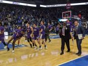 Evansville Purple Aces celebrates its first win over a ranked team, No. 1 Kentucky Wildcats
