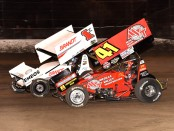 The late Jason Johnson racing side-by-side with Kyle Larson at Volusia Speedway Park