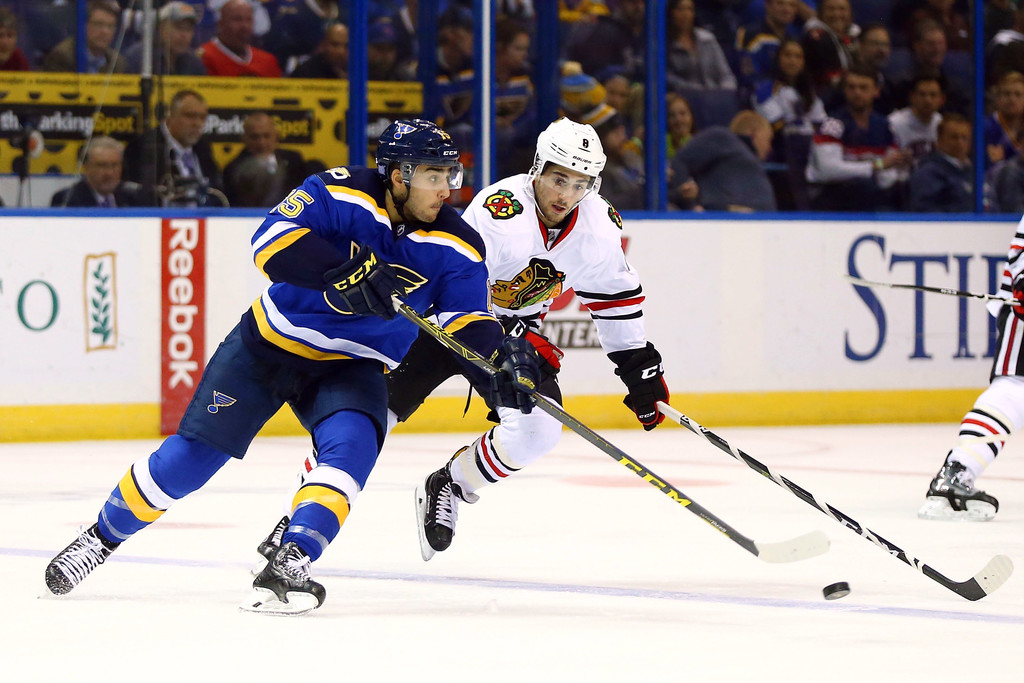 Former St. Louis Blues center Robby Fabbri controls the puck against Nick Schmaltz against the Chicago Blackhawks