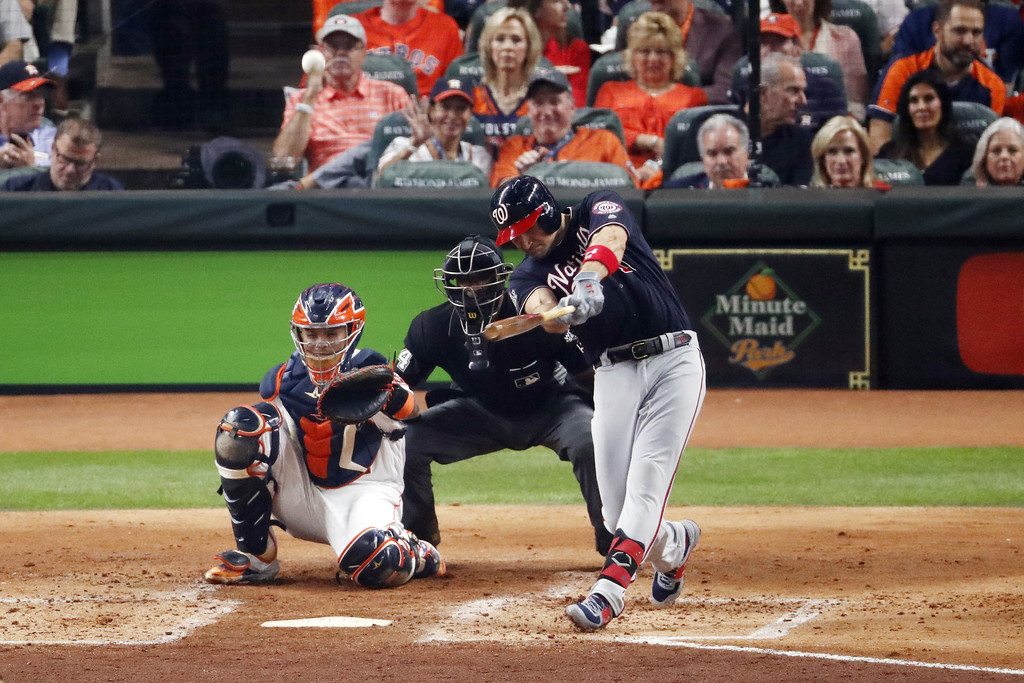 Washington Nationals first baseman Ryan Zimmerman hits a solo home run against the Houston Astros in Game One of the 2019 World Series against the Houston Astros